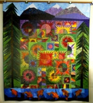 "by: contributed photo ""Sisters Scape,"" a picture quilt, has been accepted as a semifinalist at an international quilting showcase competition. The quilt depicts the Three Sisters, volcanic peaks in Oregon, surrounded by such common Northwest sights as fir trees, flowers, rivers and fish."