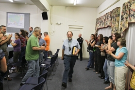 by: Chase Allgood Dave Waffle leaves Monday's Cornelius City Council meeting to a standing ovation.