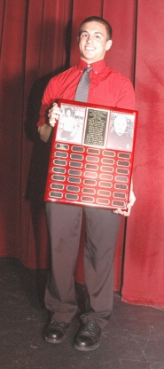 by: John Brewington Will Lawrence, the first recipient of the Ralph Painter Memorial Track & Field award.