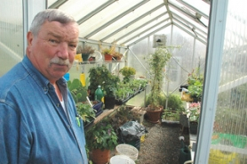 by: John Brewington MASTER—Denny Snyder has created something of a gardening paradise. He grows orchard and garden produce plus a wide variety of decorative plants.