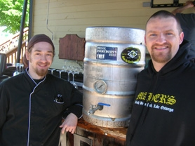 by: CLIFF NEWELL Executive chef Alex Graham, left, and owner Mark Maher plan to get plenty of use out of this 15-gallon beer-brewing kettle during the summer. Lake Oswego's Irish pub now is serving up home-brewed beer.