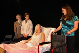 by: Lisa K. Anderson Rose, played by Lexy Dillon, keeps her spirit when hospitalized for Alzheimer's. Here she is flanked, from left, by Walter, played by Glenn Russell; Dr. Phillis, played by Carita Louise Gilmore; and Monica, played by Rebecca Tyree.