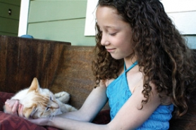 by: Lisa K. Anderson Sandy Mountain Festival Princess Faith Francis aspires to be a veterinarian. For now, the 9-year-old tends to her cat, Chrissy.