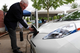 by: JAIME VALDEZ Charging a Nissan Leaf all-electric car is as easy as plugging it in, says Art James, EV program manager for the Oregon Department of Transportation. James brought one of ODOT's five Leafs to the dedication of the first federally-funded public charging station at Wilsonville City Hall on Tuesday.
