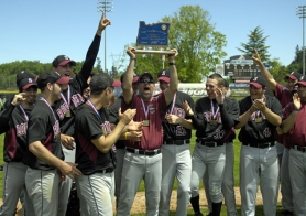 by: DAN BROOD CHAMPS — Sherwood baseball coach Jon Strohmaier, surrounded by Bowmen players, holds up the state championship trophy.
