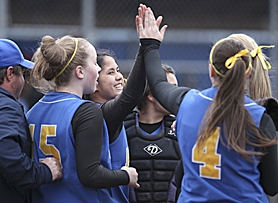 by: Tom Patterson FRIENDS, TEAMMATES — Aloha pitcher Serenil Sierra high-fives teammate Kiana Wood during the Warriors' Class 6A state semifinal game at South Salem on May 31-June 1.