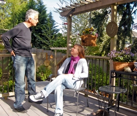 by: Barbara Sherman Noni Inman chats with garden designer Paul Taylor on her home's upper deck in the back yard. They made radical changes to the deeply sloped back yard where the builder had made minimal improvements.