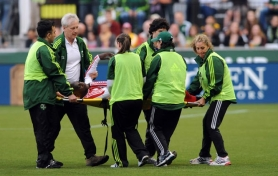 "by: STEVE DYKES Portland Timbers defender Mamadou ""Futty"" Danso is carried off the pitch at Jeld-Wen Field after his shoulder injury Saturday versus Colorado."