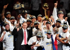 by: MARK RALSTON Coach Rick Carlisle and the Dallas Mavericks celebrate their NBA title after Game 6 Sunday at Miami.