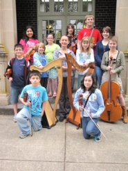 by: Courtesy photo A dozen students from the Forest Grove School District strings program, which was eliminated this spring in budget cuts, are helping their parents fundraise to keep the classes going next fall.