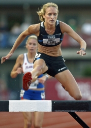 by: JAIME VALDEZ UP AND OVER — Tualatin High School graduate Kelly Strong clears an obstacle during the 3,000-meter steeplechase competition during the 2008 U.S. Track and Field Olympic Trials held in Eugene.