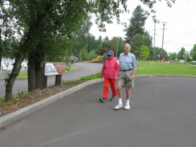 by: Raymond Rendleman Milwaukie residents Jim and Bonnie Brink walk from the northern end of Riverfront Park, where construction is beginning to revamp the park, to the southern end, where disagreements between the city and county on the future of the sewage treatment plant have put master planning on hold.
