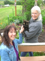 by: CLIFF NEWELL Monique Terner, left, and Karen Davis, along with their able assistant Roxy the cat, are looking forward to the best summer ever at Luscher Farm.