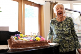 by: Jaime Valdez Edna Britten smiles after blowing out her candles Monday at the Hearthstone of Beaverton Assisted Living Community.