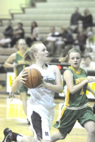 by: MATTHEW SHERMAN Megan Longtain makes a drive to the basket during West Linn's opening round victory over Cleveland last Friday at West Linn High School.