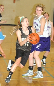 by: John Brewington INCOMING FROSH—St. Helens soon-to-be freshman Rianne Tupper drives the ball to the hoop during a game against Hermiston at Liberty last week. The Lady Lions have a new coach, a new attitude and much better prospects this year.