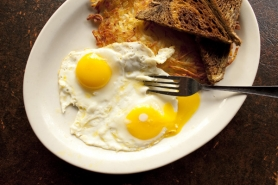 by: CHRISTOPHER ONSTOTT The Cheerful Tortoise in Southwest Portland offers a $1.99 plate of eggs – perfect for the hungry, frugal traveler.
