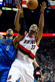 by: Christopher Onstott Trail Blazers center Marcus Camby, beating Dallas' Tyson Chandler for a rebound, says he hopes that younger NBA players will get involved in the league's collective-bargaining issues.