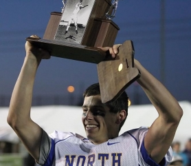 by: MILES VANCE Lincoln High quarterback Peter Williams holds up the MVP trophy after leading the North to a come-from-behind, 42-38 victory over the South in Saturday's Les Schwab Bowl at Hillsboro Stadium.