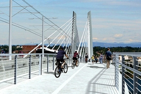 by: Courtesy of TriMet A rendering shows pedestrians, bicyclists and light-rail trains using the new $134 million bridge over the Willamette River. The bridge is part of the 7.3-mile Portland-to-Milwaukie light-rail line and extends from the South Waterfront across the river near OMSI.