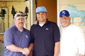 by: Courtesy photo Former Gaston High School baseball star Cody Fassold poses with his grandfather, Bob Fassold (right), and Kansas City Royals scout Scott Ramsay (left) after signing a free agent contract earlier this month. Fassold began his professional baseball career last week in Surprise, Ariz.