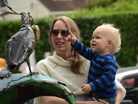 "by: vern uyetake Libby Crock and two year-old Caleb of Portland enjoy the outdoor scupture ""A  Very Old Story"" by Oregon City artist Ben Dye, which was on display outside of the Lakewood Center as part of this year's Festival of the Arts."