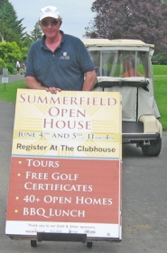 by: Barbara Sherman SIGN MAN — Ron Lynch wheels away a sign set up to promote the Summerfield Showcase on June 4 and 5 as the event drew to a close Sunday.