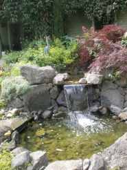 by: Courtesy of Barbara Blossom Ashmun The sound of splashing water adds an element of tranquility to the Ebert-Boundy garden.