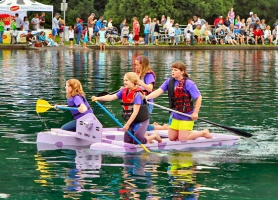 "by: David F. Ashton Lewis Elementary fifth-graders Charlotte Nicholson, Sydney Toops (in back) Danielle von Peger and Kate Kelly paddle ""Purple Cow"" to victory."