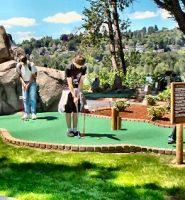 "by: David F. Ashton Families should enjoy playing the new 18-hole ""Adventure Golf Course"" at historic Oaks Amusement Park."