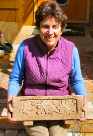 "by: Merry MacKinnon Woodstock resident Catherine Failor holds a ""hypertufa"" planter that she made recently. As one of the organizers of the upcoming Woodstock Famers Market, Failor will demonstrate how to make hypertufa planters at the market, which opened Sunday, June 26."