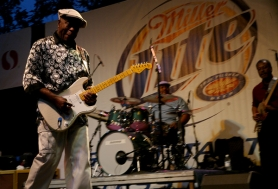 "by: Becca Quint Blues legend Buddy Guy bent a few notes Sunday evening on the 2011 Safeway Waterfront Blues Festival's main stage. Guy closed the show with a set of blues played so funky ""you could smell it."""