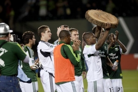 by: BECCA QUINT Darlington Nagbe holds the log symbolic of his first MLS goal as the Timbers leave Jeld-Wen Field with a 2-1 loss Saturday night to Sporting Kansas City.