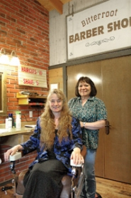 by: Gus Jarvis As one chapter closes, another chapter opens. JoAnne Jaggers, front, and Linda Tiffany share a moment in the Bitterroot Barber Shop, which Tiffany owns.