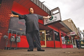 by: Jaime Valdez Juan Carlos stands outside his Southeast Portland restaurant. Carlos spent two months living in Tigard's Good Neighbor Center before he was able to get his life turned. Now his son, Antonio Carlos, below, works alongside him.