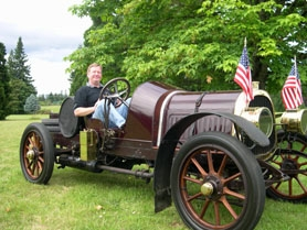by: Submitted photo Phil Hutchinson of Aloha sits in the 1909 Pope-Hartford that he's been taking to the Concours d' Elegance in Forest Grove since the early 1980s though never before for judging.