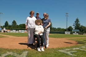 by: SUBMITTED PHOTO Carol Abramson, seated, visited Lakeridge's Abramson Field which was named after her son Andrew who died in a plane crash in Vietnam. She was joined by her daughter and son-in-law Peggy and Gary Thompson and two friends.