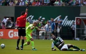 by: CHRISTOPHER ONSTOTT Seattle's Osvaldo Alonso (left) yells at Portland's James Marcelin and draws a yellow card during Sunday's match at Jeld-Wen Field.