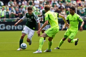 by: BECCA QUINT Sal Zizzo of the Portland Timbers drives past Seattle's Tyson Wahl and Lamar Neagle. The Sounders rallied for a 3-2 victory Sunday at Jeld-Wen Field.