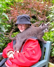 by: Barbara Blossom Ashmun Local garden writer Dulcy Mahar and her cat enjoyed a quiet moment among her plants. Mahar, who died July 2, 2011, will be remembered for her love of gardening.