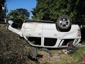 by: Submitted photo One passenger was injured Saturday morning after this 2003 Chevrolet Tahoe flipped over.
