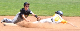 by: John Brewington  DIVING TAG—St. Helens' Tucker Mosley dives to make a tag against Peninsula player during Saturday's semifinal game. St. Helens lost and finished third in the tournament.