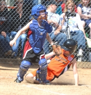 by: John Brewington HOME SAFE—Scappoose's Montana Poppenhagen is safe at home during the 9-10s softball win over Willamette Red on Friday.