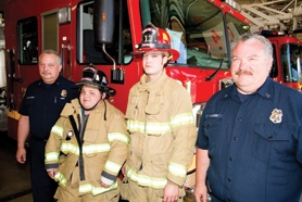 by: Chase Allgood Dwight Lanter (left) and his sons Andrew (center left) and Chris (center right), along with his brother, Mike, have collectively put in 69 years of service as volunteers or staffers at western Washington County fire departments.