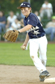 by: David Ball Gresham's Ethan Rose works for a double play during an earlier game.
