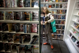 by: Christopher Onstott Carol Sherman browses the aisles of Trilogy, a family-owned video store on Northwest Thurman Street, for movies and audio books as the store sells its remaining stock before closing.