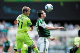 by: Christopher Onstott Kenny Cooper (right), veteran Portland Timbers forward, heads a ball away from the marking of Seattle's Jeff Parke in last week's 3-2 loss at Jeld-Wen Field.