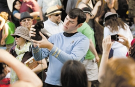 "by: Christopher Onstott Jesse Graff, dressed as ""Spock,"" poses for a fan photo holding a kitten during a ""Star Trek in the Park"" show at Woodlawn Park."