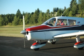 by:  Shane Licari and pilot Steve Miller return to the hangar after an exhilarating flight over Estacada last week.