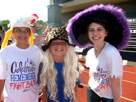 by: submitted photo Modeling their wacky hat fashions are, from left, Juliana Sahni, Nicholas May-Varas and Allison Cohen. Wearing funny hats was a focus during one hour of the relay.